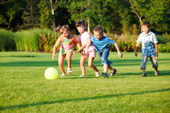 Kids with ball. Kids playing with the ball royalty free stock photo
