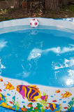 Kids ball in the pool with wather in it Royalty Free Stock Images