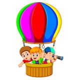 Kids in a balloon Stock Images