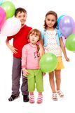 Kids with balloons. Portrait of kids with colorful balloons at birthday party Stock Photography