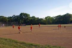 Kids on a Baseball Field Stock Photography