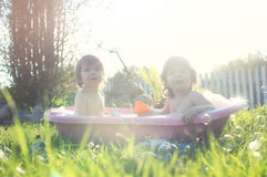 Kids in bath water outdoor Stock Image