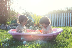 Kids in bath water outdoor Stock Photo