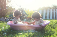 Kids in bath water outdoor Royalty Free Stock Photo