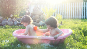 Kids in bath water outdoor Royalty Free Stock Images