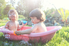 Kids in bath water outdoor Stock Photography