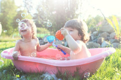 Kids in bath water outdoor Stock Images