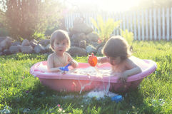 Kids in bath water outdoor Stock Photos