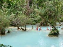 Kids bathing near the Waterfall near Luang Prabang / Laos Royalty Free Stock Photo