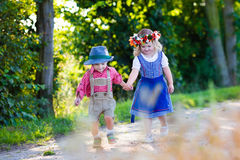 Kids in Bavarian costumes in wheat field Royalty Free Stock Photos