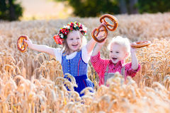 Kids in Bavarian costumes in wheat field Royalty Free Stock Images