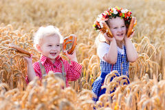 Kids in Bavarian costumes in wheat field Royalty Free Stock Image
