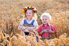 Kids in Bavarian costumes in wheat field Royalty Free Stock Photography