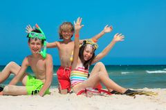 Kids on beach. Three kids playing in the sand on the beach Stock Photography