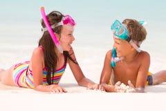 Kids on the beach stock photos