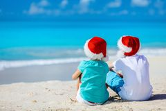 Kids at beach on Christmas Stock Images