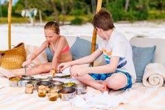 Kids at beach picnic stock photography