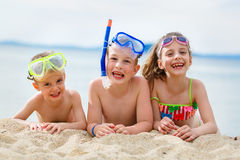 Kids on beach. Playful children on the sand after scuba diving in the sea Stock Photography