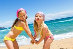Kids on beach pulling funny faces. Royalty Free Stock Photography