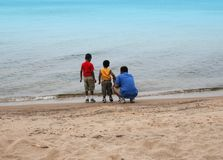 Kids on the beach side Royalty Free Stock Images