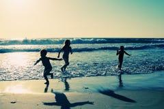 Kids on the beach. At sunset stock photo