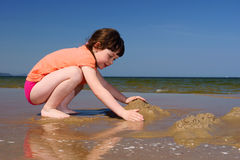 Kids on the beach to make sandcastles Stock Images