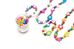Kids beaded jewellery. On white royalty free stock images