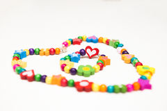 Kids beaded jewellery. On white royalty free stock photography