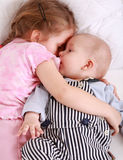 Kids in bed royalty free stock photo
