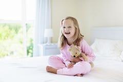 Kids in bed. Children in pajamas. Family bedroom. Royalty Free Stock Image