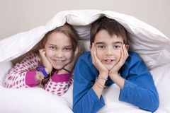 Kids in bed Royalty Free Stock Photography