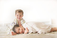 Kids in bed after shower. Two kids in bed after shower Royalty Free Stock Photo