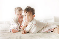 Kids in bed after shower. Two kids in bed after shower Royalty Free Stock Photos
