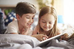 Kids in bed royalty free stock image
