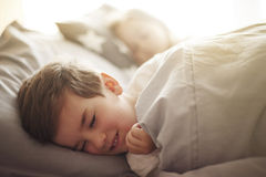 Kids in bed Stock Photography
