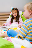 Kids in bedroom Stock Images