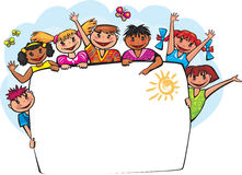 Kids behind the banner. Group of Kids standing behind placard boards Royalty Free Stock Image