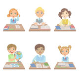 Kids Behind the Desks In School Set Royalty Free Stock Photography