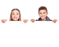 Kids behind a white board royalty free stock images