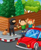 Kids being robbed at the road corner Royalty Free Stock Photography