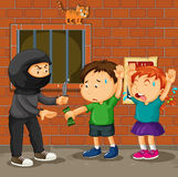 Kids being robbed on the street Stock Image