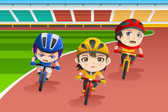 Kids in a bicycle race Stock Image