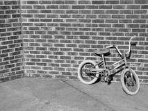 Kids bike. Bicycle near brick wall Royalty Free Stock Photo