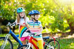 Kids on bike. Children on bicycle. Child biking stock image