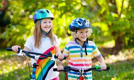 Kids on bike. Children on bicycle. Child biking stock photos