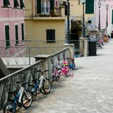 Kids bike parking, childhood. Childrens parking with bike, young life Stock Images