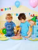 Kids and birthday cake Royalty Free Stock Photos