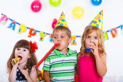 Kids with birthday cake Royalty Free Stock Images