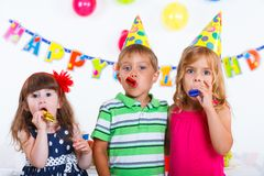 Kids with birthday cake Stock Images