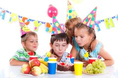 Kids with birthday cake Royalty Free Stock Photography
